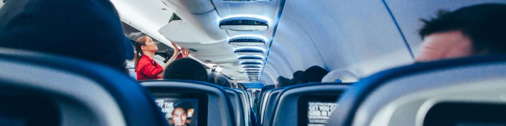 cabin crew shutting overhead bin