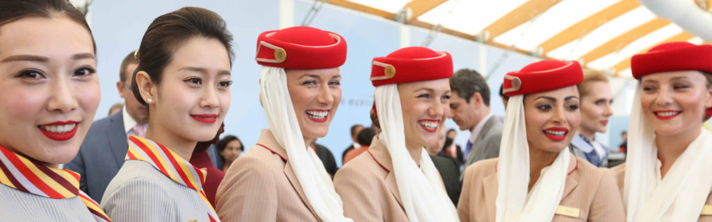hainan airlines and emirates cabin crew pose for photo