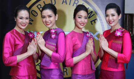 thai airways staff pose for the camera