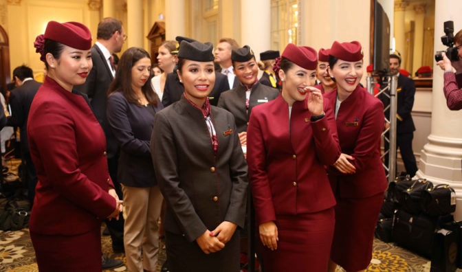 qatar airways cabin staff share a smile