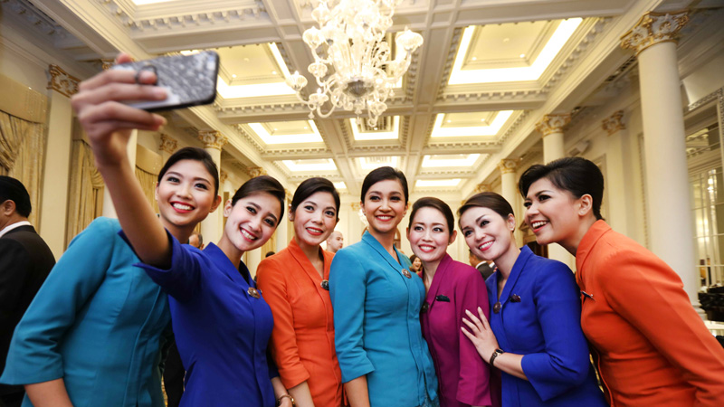 garuda indonesia crew celebrate with a group selfie
